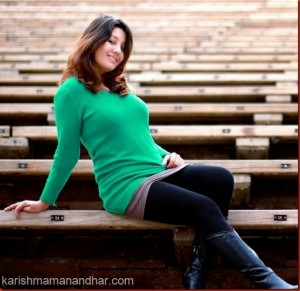 karishma manandhar green sweater pose 2